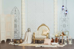 White and gold interior chair and tables in Oriental style. Moroccan middle East Decoration in Eastern Arabic style design. White room in Oriental style