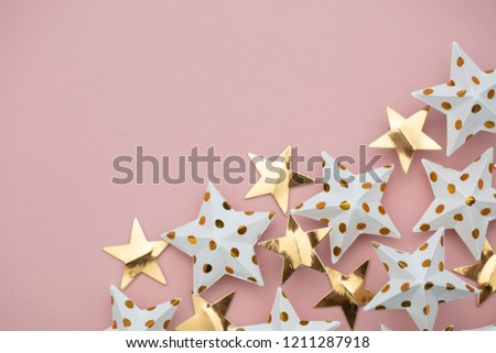 White and gold star decorations on a pastel pink. Seasonal festive background #1211287918