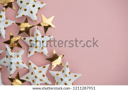 White and gold star decorations on a pastel pink. Seasonal festive background #1211287951
