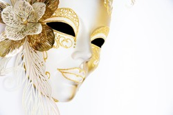 White and gold venetian festive mask on a carnival. Masquerade celebration mask on white background copy space
