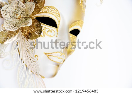 White and gold venetian festive mask on a carnival. Masquerade celebration mask on white background copy space #1219456483