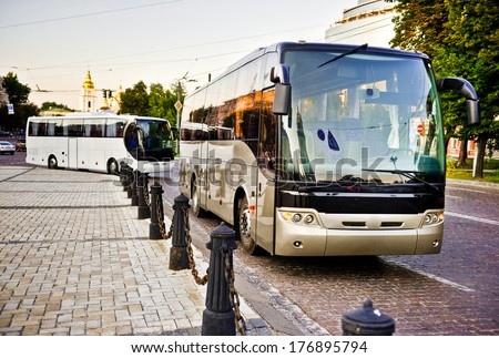 White and gray bus on the road