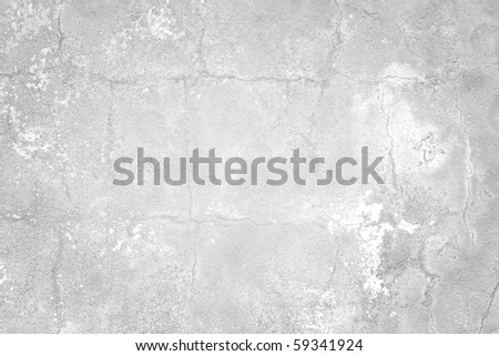 white and gray textured wall with cracks