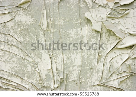 white and gray wall with old peeling paint