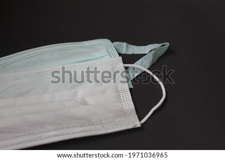 White and green mask for virus protection Stok fotoğraf ©