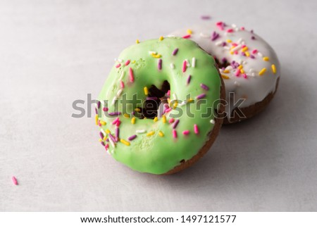 White and green Sprinkled delicious doughnuts