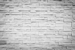 white and grey color brick block wall background texture with vignette dark shadow effect for mock up design as presentation ppt or simple banner ads concept