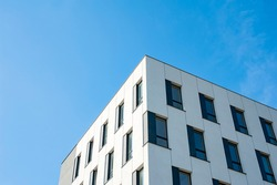 White and grey facade of modern office building
