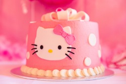 White and Pink Birthday Cake with Cat Head and Blurred Background