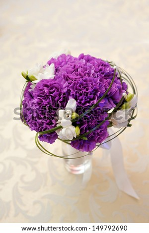white and purple flowers on the wedding table