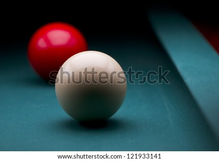 White and red carom balls with dark backgroud