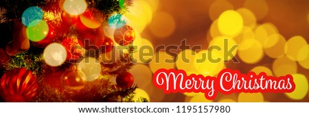 White and red greeting card against defocused of christmas tree lights and fireplace #1195157980