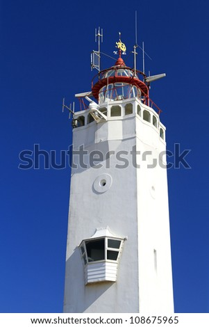 White and red lighthouse on the dutch coast in Noordwijk