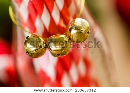White and red paper straws in glass jar.