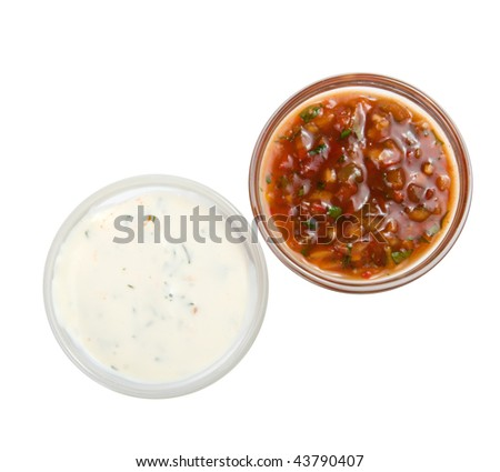 White and red sauces isolated on a white background