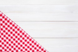 White and red tablecloth textile texture on wooden table background