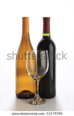 White and red wine bottles with an empty glass
