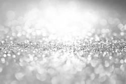 white and silver abstract bokeh lights. defocused background bling blur for christmas