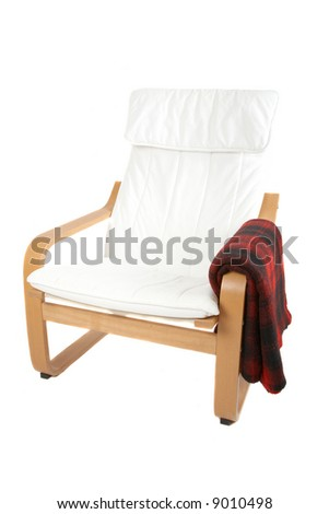 White and wood armchair with a red blanket isolated on white