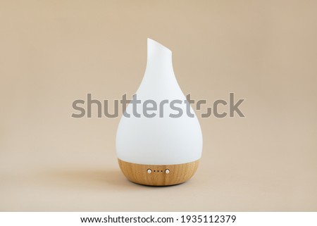 White and wood essential oil diffuser on tan background Stock foto ©