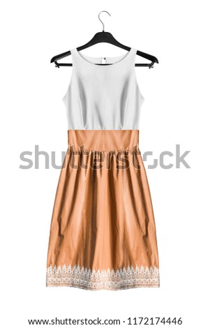 c4543e73f3e White and yellow flared sundress hanging on black clothes rack isolated  over white  1172174446