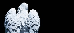 White angel of death against black background as a symbol of the end of life. Ancient statue. (Religion, eternal life, immortality, faith concept)