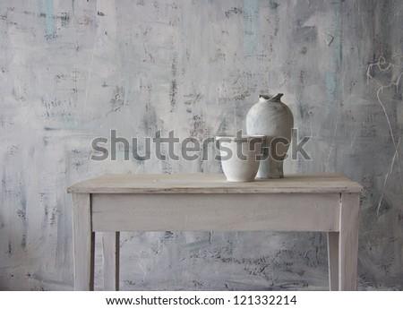 White antique vase in white interior. #121332214
