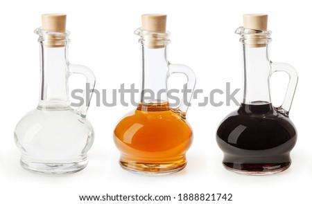White, apple cider and balsamic vinegar in glass bottles isolated on white background Foto stock ©