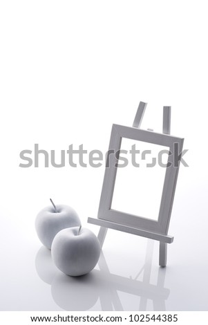 white apple objet and easel
