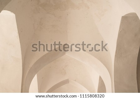 White arches and arches of the corridor in Kalyan mosque. Ancient buildings of medieval Asia. Bukhara, Uzbekistan #1115808320