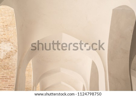 White arches and arches of the corridor in Kalyan mosque. Ancient buildings of medieval Asia. Bukhara, Uzbekistan #1124798750