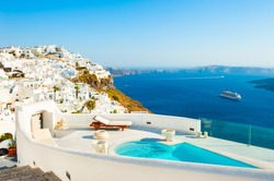 White architecture and blue sea on Santorini island, Greece. Luxury swimming pool with sea view. Famous travel destination