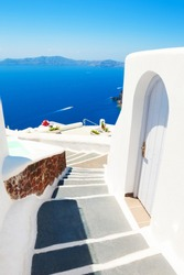 White architecture and blue sea on Santorini island, Greece. Summer holidays, travel destinations concept