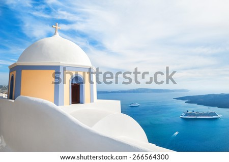 White architecture on Santorini island, Greece. Church in Fira town. Beautiful landscape with sea view