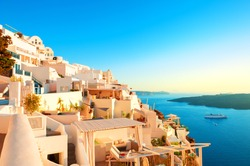 White architecture on Santorini island, Greece. Panoramic view at sunset. Famous travel destination
