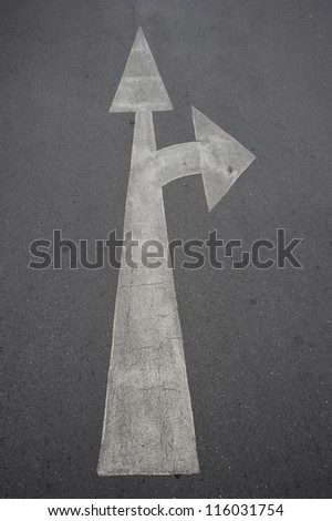 white arrow marking on road