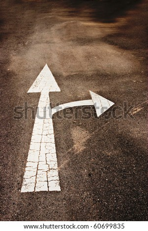 white arrow marking on road