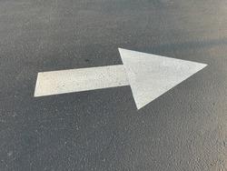 White Arrow Road Marking Painted on Asphalt