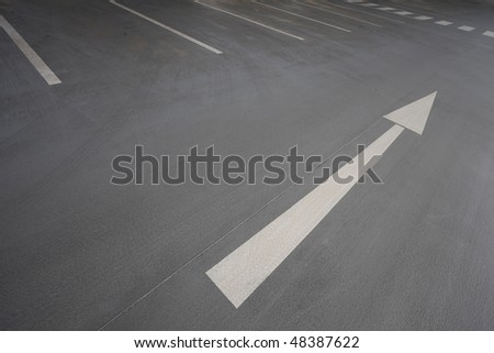 White arrow signt pointing up