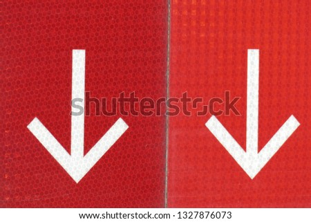 White arrows on red background, direction sign, arrow signpost #1327876073