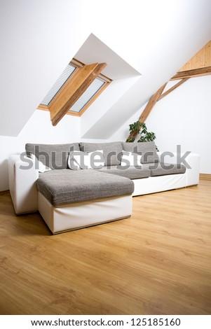 White attic room with a sofa