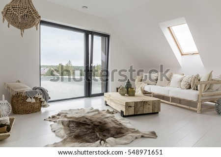 White attic room with balcony and wooden decorative accessories #548971651