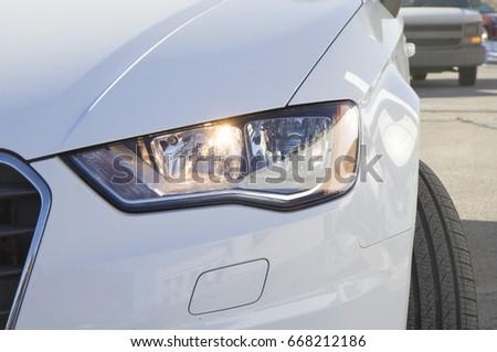 Photo of White Audi car headlight, beam