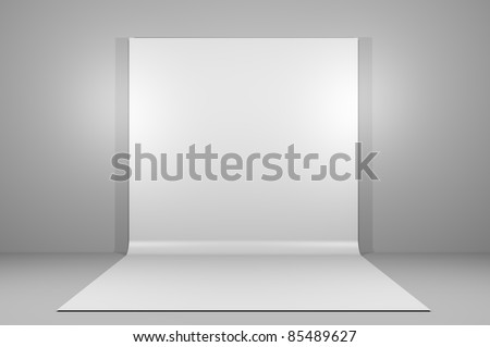 White backdrop in empty room with grey paint on wall
