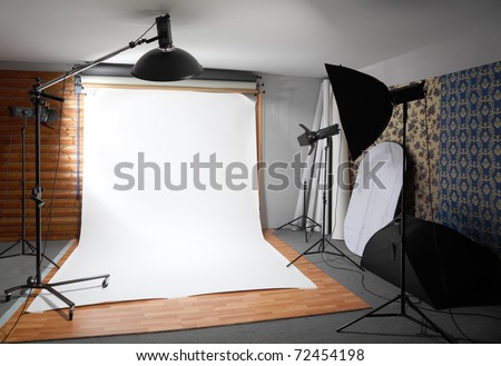 White background inside studio - dark room lighted big lamps and spotlights