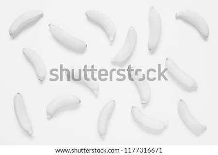 White background of small bananas, monochromatic conceptual composition  #1177316671