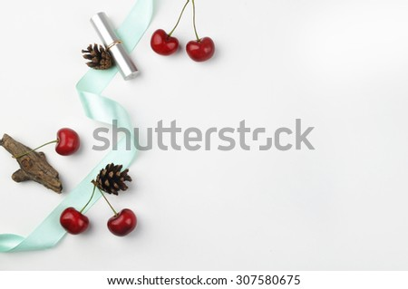 white background table, view table mockup, cherry and lipstick