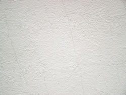 White background with grain and roughness. Stock photo of thin cracks on a light surface.