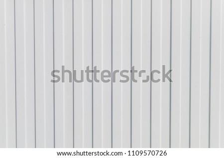 White background with horizontal stripes. White metal fence with horizontal stripes. Horizontal stripes on a white background for designer #1109570726