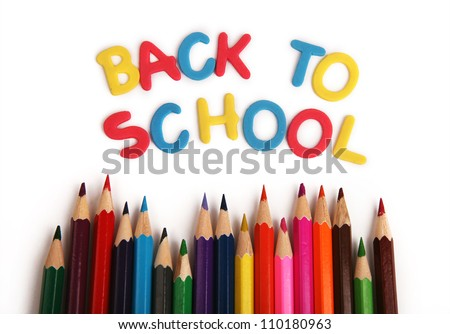 "White background with inscription ""Back to school"" and colored pencils"